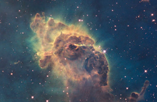 Composed of gas and dust, the pictured pillar resides in a tempestuous stellar nursery called the Carina Nebula, located 7500 light-years away in the southern constellation of Carina. Taken in visible light, the image shows the tip of the three-light-year-long pillar, bathed in the glow of light from hot, massive stars off the top of the image. Scorching radiation and fast winds (streams of charged particles) from these stars are sculpting the pillar and causing new stars to form within it. Streamers of gas and dust can be seen flowing off the top of the structure. Hubble's Wide Field Camera 3 observed the Carina Nebula on 24-30 July 2009. WFC3 was installed aboard Hubble in May 2009 during Servicing Mission 4. The composite image was made from filters that isolate emission from iron, magnesium, oxygen, hydrogen and sulphur. These Hubble observations of the Carina Nebula are part of the Hubble Servicing Mission 4 Early Release Observations.