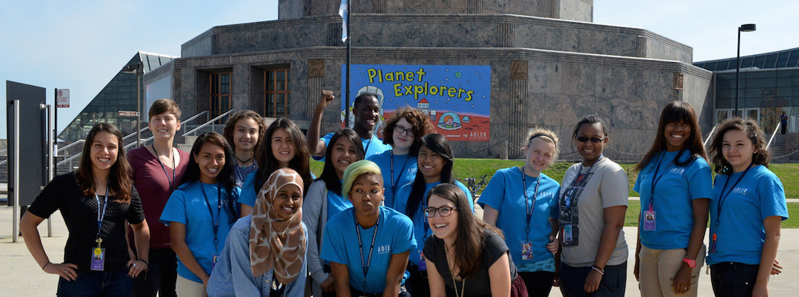 Adler Teens pose in front of the Adler Planetarium.